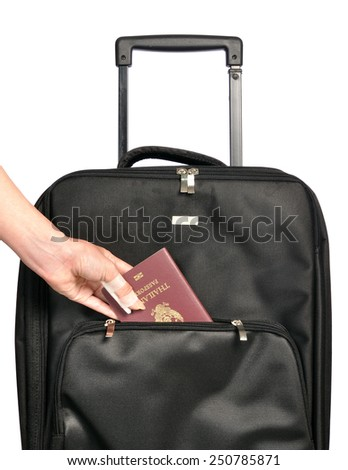 Injured hand putting passport in suitcase during a vacation, travel insurance concept - stock photo