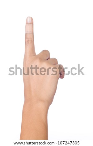 Injured index finger covered by plaster on white background