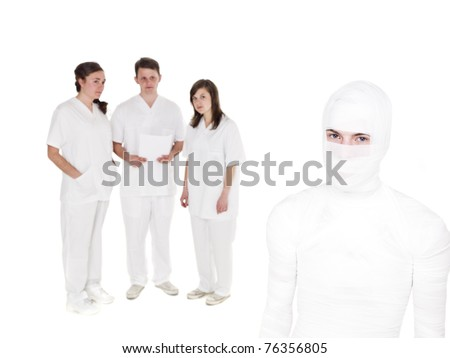 Injured man in front of a Doctors Team - stock photo