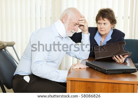 Injured man in pain, discussing a lawsuit with his attorney. - stock photo