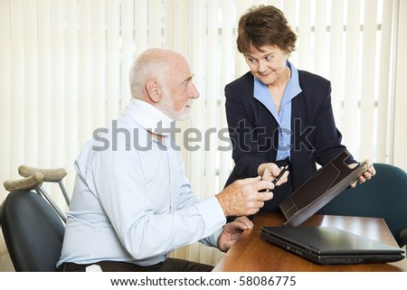 Injured man signing a settlement offer from the attorney. - stock photo