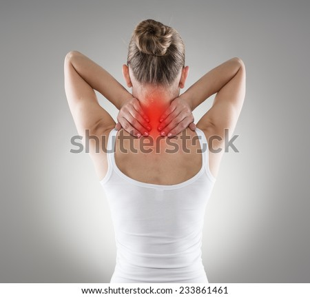 Injured neck. Young female suffering from spine disease. Inflammation, pain and treatment.  - stock photo