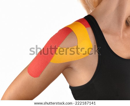 Injured shoulder therapy with kinesio tex tape. - stock photo