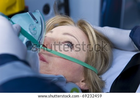 Injured Woman Receiving First Aid Assistance - stock photo