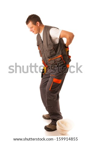 Injury on work - construction worker suffering hard pain in his back - stock photo