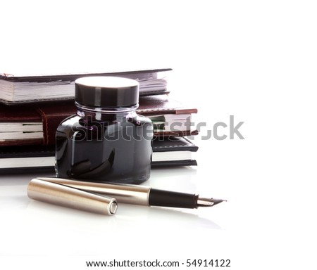 Ink and pen isolated on white - stock photo