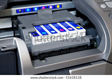 Ink cartridges in printer - stock photo