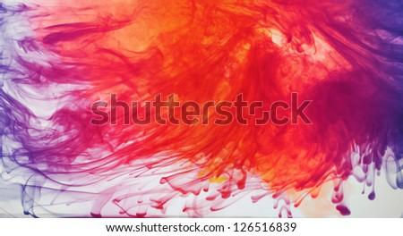 Ink dispersing in water - stock photo
