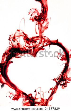 Ink Drop formed as a heart in red - stock photo