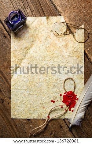 Ink, feather, glasses and red sealing wax on old vintage paper - stock photo