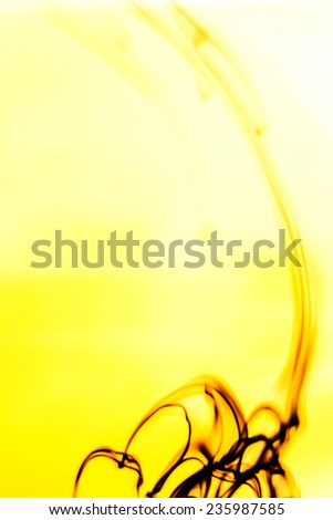 Ink in the water/ Black and yellow - stock photo