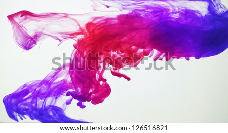 Ink in water. Blue, purple, pink and red - stock photo