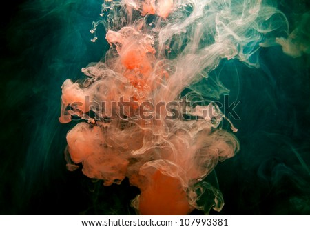 Ink in water on a black background. - stock photo