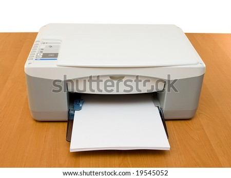 Ink-jet printer placed on a wood table - stock photo