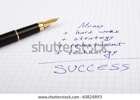 Ink pen on the paper with some business quotes - stock photo
