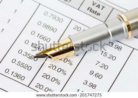Ink pen on the printed invoice  document - stock photo
