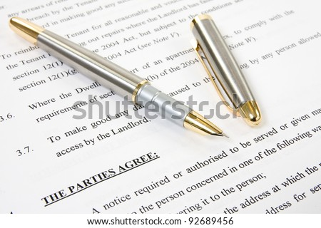 ink pen with agreement between landlord and tenant - stock photo