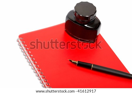 ink pen with notebook - stock photo