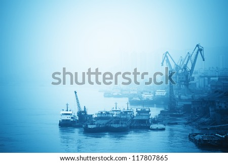 inland port with crane and cargo ship in yangtze river,China - stock photo