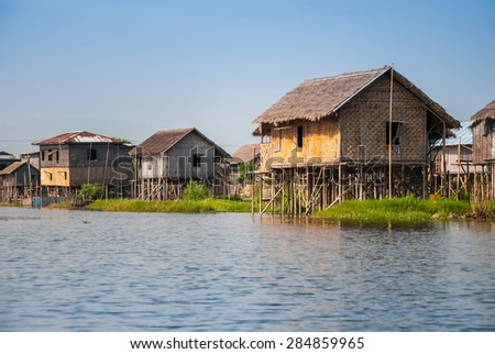INLE LAKE, MYANMAR - APRIL 10: Floating houses in a village on APRIL 10, 2012 in Inle Lake, Myanmar. Inle lake is a famous lake for tourism in Myanmar.