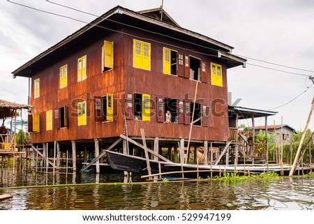 INLE LAKE, MYANMAR - AUG 30, 2016: Wooden architecture of the Inpawkhon village over the Inle Sap,a freshwater lake in the Nyaungshwe Township of Taunggyi District of Shan State, Myanmar