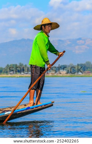 INLE LAKE, MYANMAR - DEC 8: Intha Fishermen on Dec 8, 2014 in Inle. The Intha are known for their leg-rowing techniques and are traditionally Buddhists.