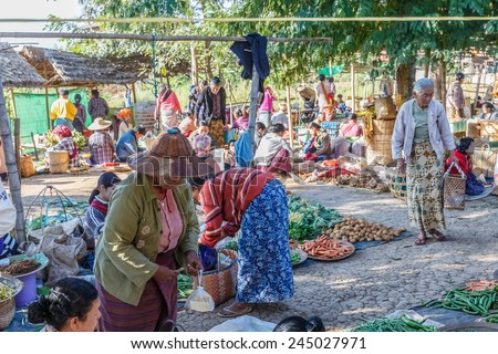 INLE LAKE, MYANMAR - DEC 8: Local traders at 5 Day market on Dec 8, 2014 in Inle. Hand-made goods and food for local use and trading are another source of commerce in Inle.