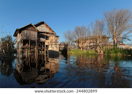 INLE LAKE, MYANMAR, December 14, 2014 : Village on the Lake. People built on the water its houses on piles and lives on culture of fruits, vegetables and flowers on incredible floating islands