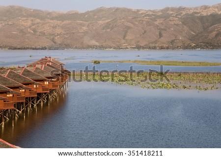 INLE LAKE, MYANMAR - FEB 19, 2011- Dusk, Floating cottages of Hupin Hotel on Inle Lake, Myanmar (Burma) on February 19, 2011 - stock photo