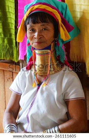 INLE LAKE, MYANMAR - FEB 28, 2015 - Long necked Kayan Padaung woman poses for her portrait,   Inle Lake,  Myanmar (Burma) - stock photo