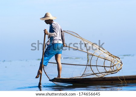 INLE LAKE, MYANMAR - FEBRUARY 17: Fisherman catches fish for food on February 17, 2011 on Inle Lake, Myanmar. Intha people possess the leg-rowing style and the unique coop-like fishing equipment