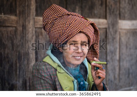 INLE LAKE, MYANMAR - JANUARY 13, 2016: Unidentified old woman on her smile face is happiness. The local people are hospitable and friendly to tourists