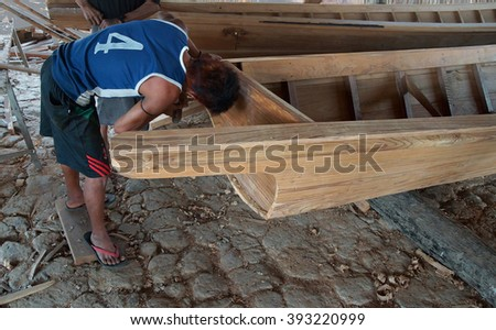 INLE LAKE, MYANMAR - MAR 1, 2015 - Boat builders work in their shop on  Inle Lake,  Myanmar (Burma)