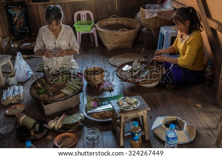 INLE LAKE, MYANMAR - NOVEMBER 23: Two ladies making cigars in a small traditional workshop at the Inle Lake. November 23 at Inle Lake, Shan State, Myanmar - stock photo