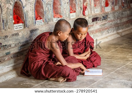 INLE, MYANMAR - DEC 8: Unidentified young buddhism novices study at Shwe Yan Pyay Temple on Dec 8, 2014 in Inle. Buddhism is predominantly of the Theravada tradition, practised by 89% of the population. - stock photo