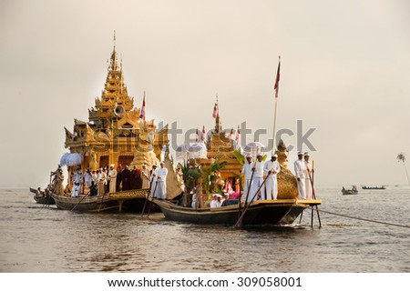 INLE,MYANMAR-SEPT 30 : The Royal Karaweik Barge on the procession in Phaung Daw Oo Festival on September 30, 2014, Inle lake ,Myanmar. The festival is the one of the biggest festivals in Shan State. - stock photo