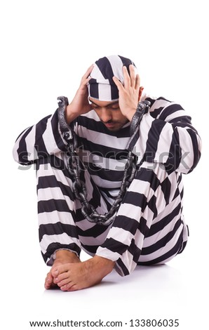 Inmate in stiped uniform on white