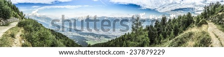 Inn river valley as seen from mountain and ski area of Patscherkofel in Tyrol region, south of Innsbruck in western Austria. - stock photo