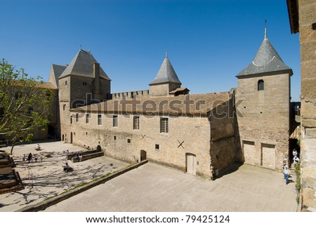 Inner building of Carcassonne chateau. Carcassonne is a ancient and fortified town in Aude department south France. It was added to the UNESCO list of World Heritage Sites in 1997. - stock photo