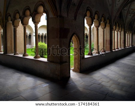 inner courtyard with arcades in the Franciscan monastery and Church Street Franciscan, Bolzano Italy - stock photo