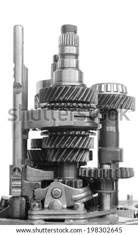 inner part of gear box in black and white on isolated background - stock photo