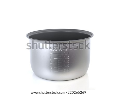 Inner pot of electric rice cooker on white background - stock photo