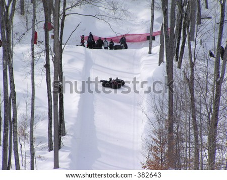 inner tube ride on snow in Quebec, Canada - stock photo