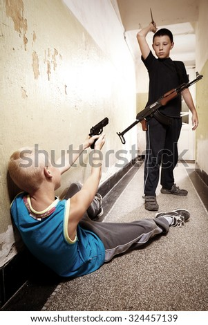 Innocent game or first fight? - stock photo