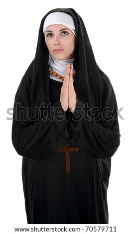 Innocent nun with palms together in prayer - stock photo