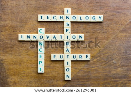 innovation crossword blocks on the wooden background - stock photo