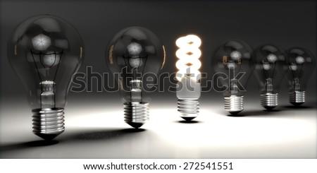 Innovation. 3D. CFL in bulbs row - stock photo