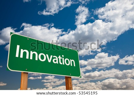 Innovation Green Road Sign with Copy Room Over The Dramatic Clouds and Sky. - stock photo