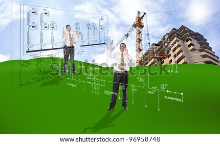 Innovative engineering building designing on a green field under the blue sky - stock photo