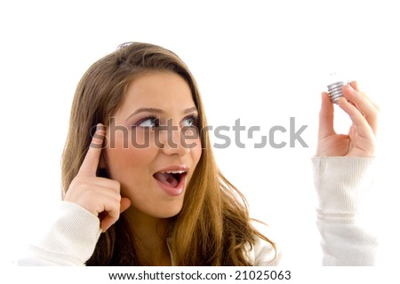 innovative female holding bulb on an isolated background - stock photo